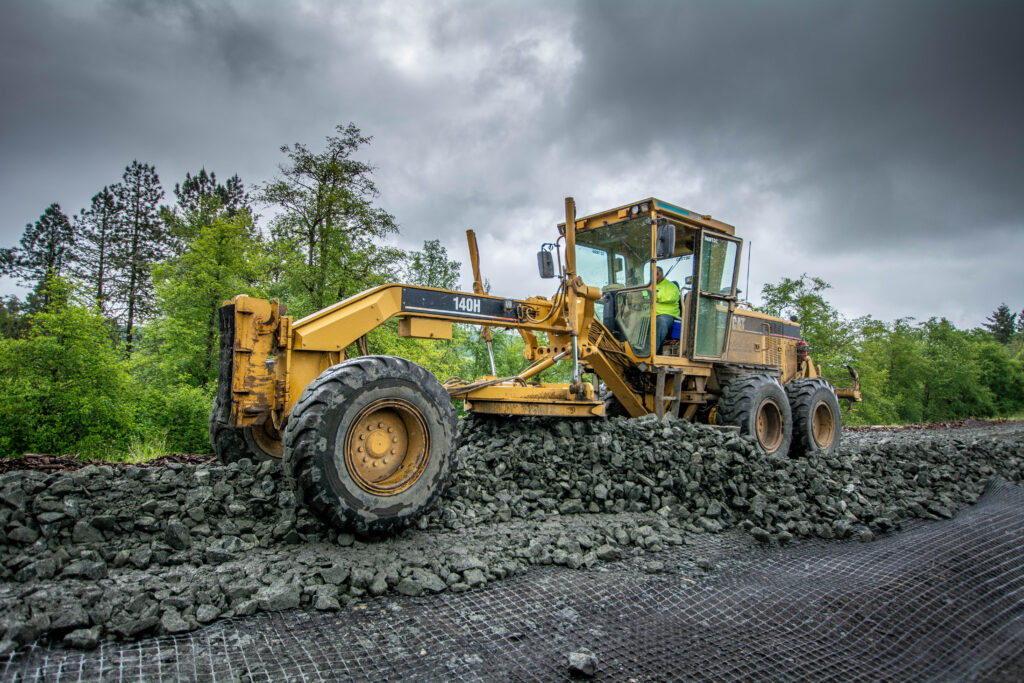 Aggregate being spread out to build a haul road